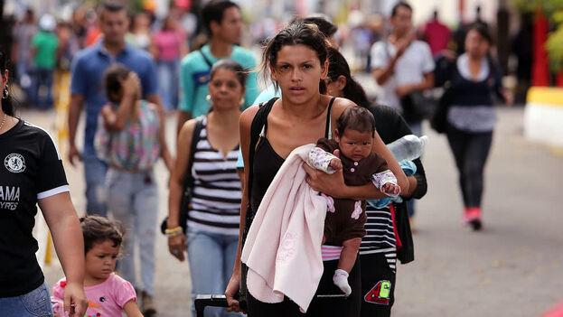 De los 1.630.903 venezolanos que hay en Colombia, un total de 327.635 (20%) están radicados en Bogotá. (EFE)