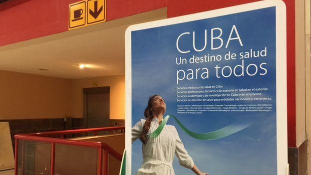 "Advertisement greeting arriving passengers at Havana's José Martí International Airport Terminal 3. Poster reads ""Cuba: A Healthcare Destination for All."" (14ymedio)"
