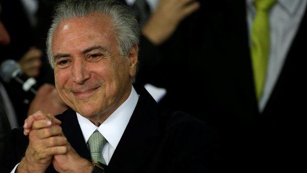 El presidente interino de Brasil, Michel Temer, toma posesión de su cargo este jueves 12 de mayo. (EFE/ Antonio Lacerda)