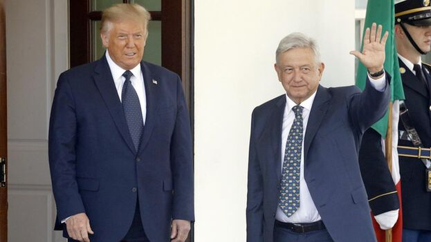 Donald Trump y Andrés Manuel López Obrador, a la llegada de este a la Casa Blanca. (EFE)
