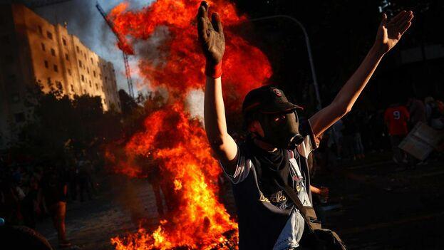 Manifestantes en Chile. (el Nuevo Herald)