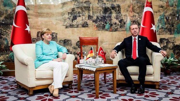 Merkel y Erdogan acercan posiciones en China tras semanas de tensiones. (EFE)