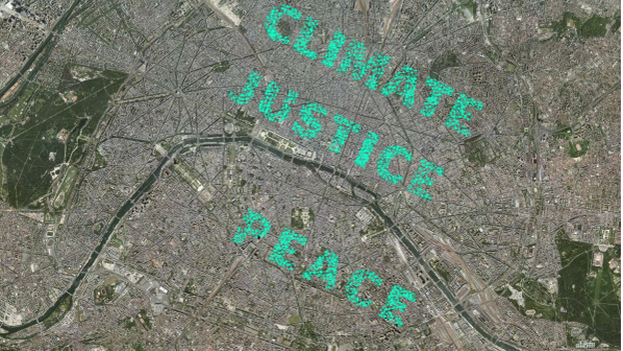 """Miles de manifestantes en Paris hacen una cadena de personas para formar las palabras """"Clima"""", """"Paz"""" y """"Justicia"""". (Greenpeace)"""
