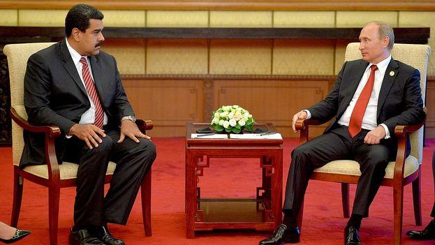 El presidente venezolano, Nicolás Maduro, y su homólogo ruso, Vladmir Putin este jueves en Pekín. (Kremlin)