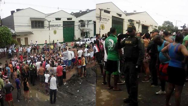 Policías y funcionarios de Migración llegan al albergue de los cubanos en Turbo. (Cortesía)