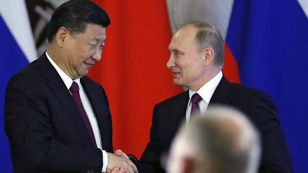 Putin y Xi acordaron este martes promover una iniciativa común para arreglar el conflicto coreano. (EFE)