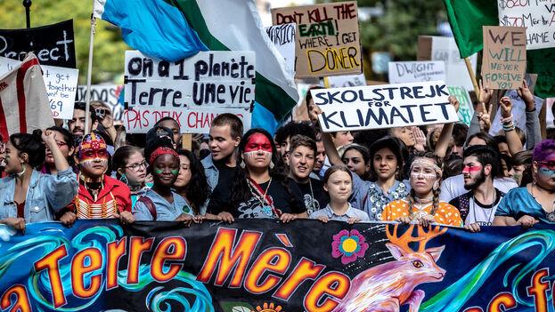 Tras reunirse con Thunberg, Trudeau participó junto con centenares de miles de personas en la marcha que recorrió Montreal para protestar, entre otras medidas, contra las políticas de su Gobierno. (David Himbert)
