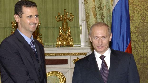 Vladímir Putin junto a Bachar al Asad durante un encuentro en Moscú en 2013. (CC)