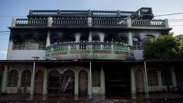 Cuatro adultos y dos niños murieron calcinados en incendio provocado por policías y paramilitares. (Carlos Herrera/Niú)