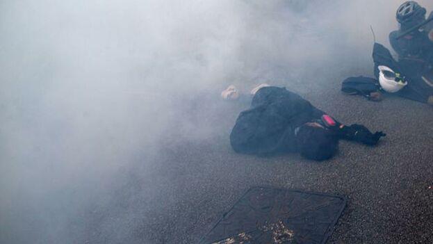 Los manifestantes condenan el autoritarismo del régimen comunista. (EFE)