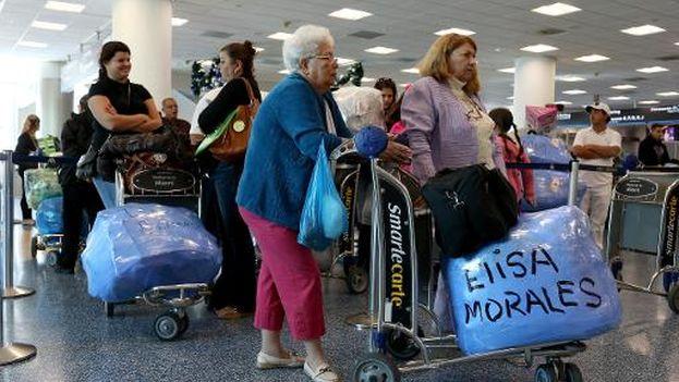 Puerta de embarque de un vuelo chárter a Cuba desde Miami. (Joe Raedle)